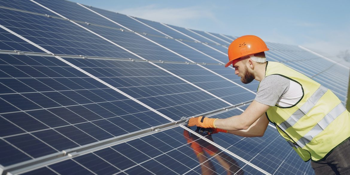 young-engineer-checking-maintenance-of-solar-panels-4254168
